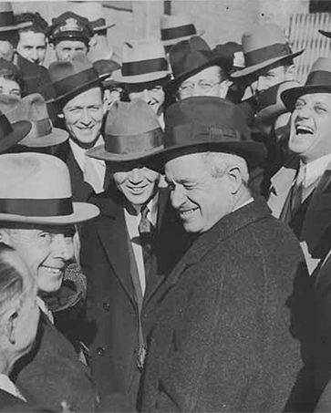 Hubert (smiling, immediate left of Will Rogers, center), Kansas City, MO
